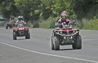 ATV riders on local roads