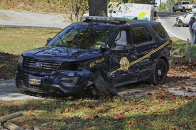 Trooper cruiser crashes with vehicle