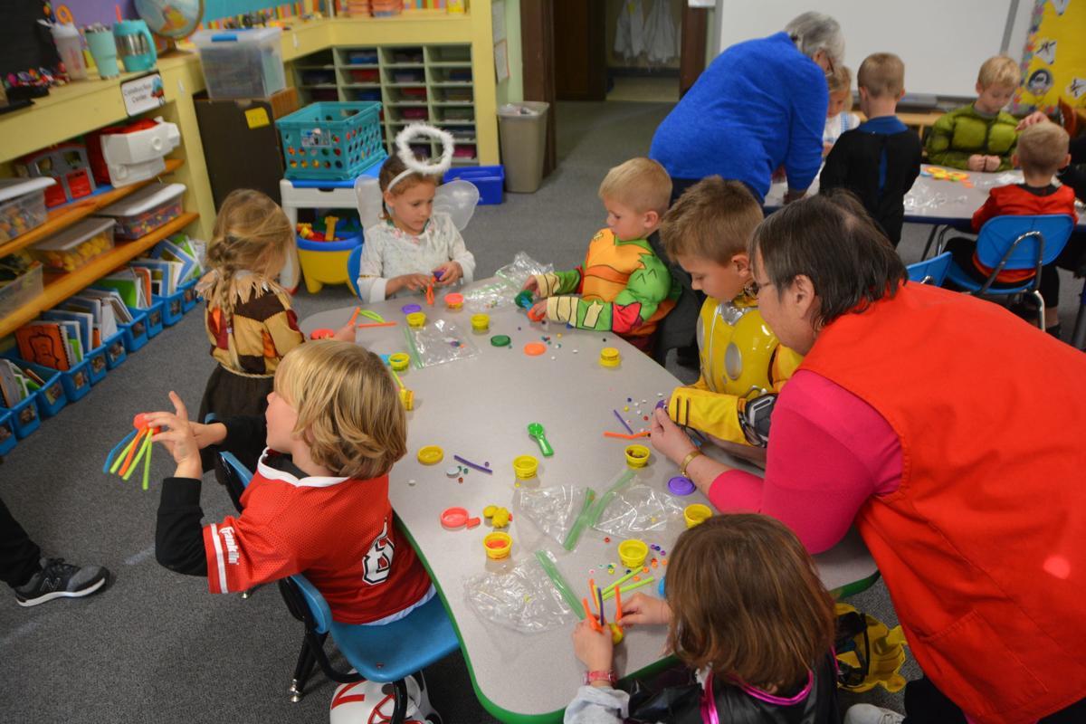 students at st. joseph's catholic school celebrate halloween and all
