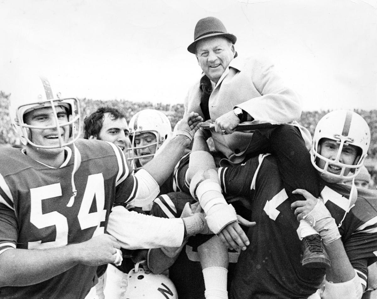 Bob Devaney being carried off the field after  win over OK in 1