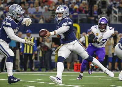 Dallas Cowboys quarterback Dak Prescott (4) hands off to running back Ezekiel Elliott (21) during the first quarter on Sunday, Nov. 10, 2019 at AT&T Stadium in Arlington, Texas.