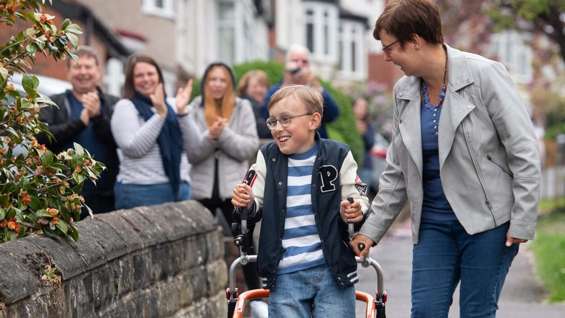 Boy, 9, with cerebral palsy completes marathon on his walker, half a mile at a time