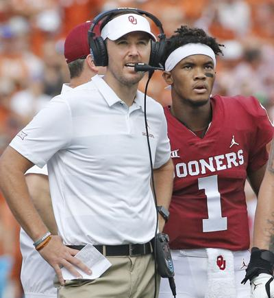 Oklahoma head coach Lincoln Riley and quarterback Kyler Murray (1) confer during a game against Texas at the Cotton Bowl in Dallas on October 6, 2018.
