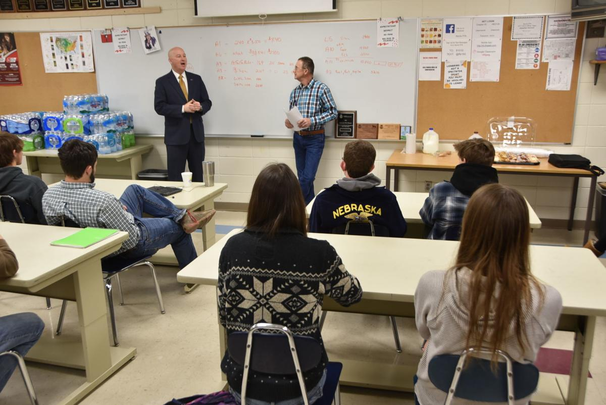 Pete Ricketts talking with Norris students