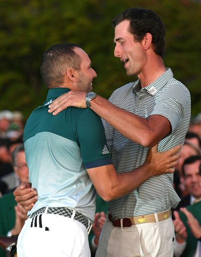 Sergio Garcia, left, is congratulated by Stewart Hagestad, right, prior to Garcia receiving his green jacket for winning the Masters Tournament on Sunday, April 9, 2017.