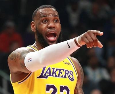 The Los Angeles Lakers' LeBron James directs his team against the Atlanta Hawks on February 12, 2019, at Philips Arena in Atlanta.
