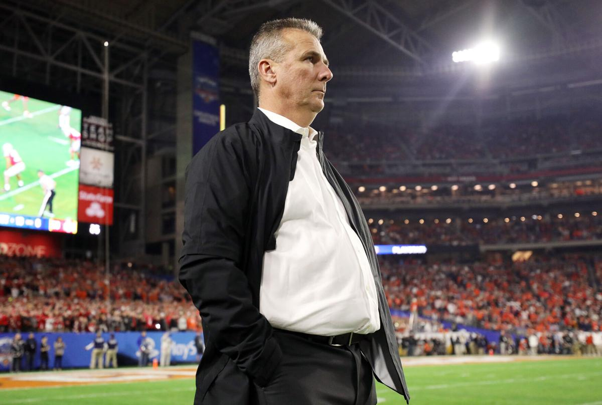 GLENDALE, ARIZONA- DECEMBER 28: Former Ohio State Buckeyes head coach Urban Meyer looks on during the College Football Playoff Semifinal between the Ohio State Buckeyes and the Clemson Tigers at the PlayStation Fiesta Bowl at State Farm Stadium on Dec. 28, 2019 in Glendale, Arizona.