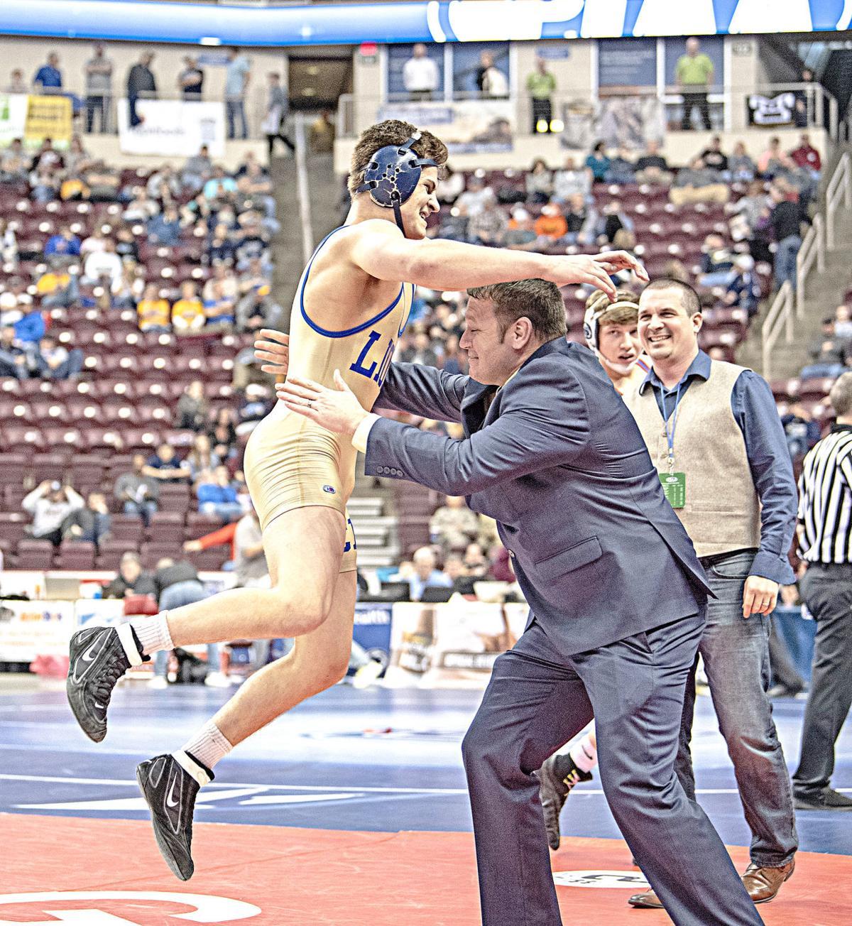 SPORTS McGill jumps into Lazor's Arms.jpg