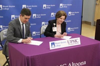 MAC-UPMC-signing.JPG