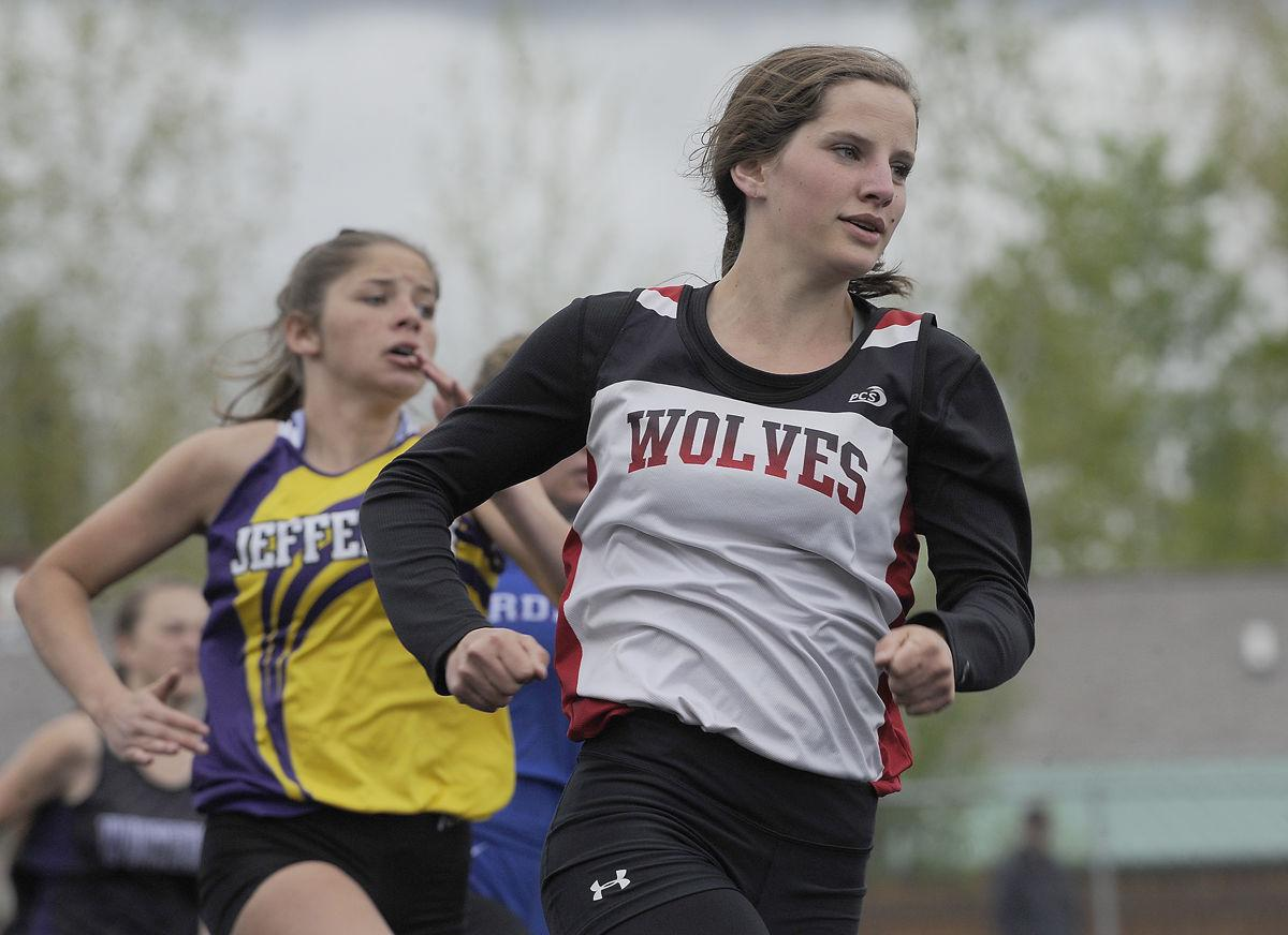 Three Forks' Sinclair Oliver leads the pack rounding the turn en route to  winning the 200-meter dash on Friday. The senior won four events at the  District ...