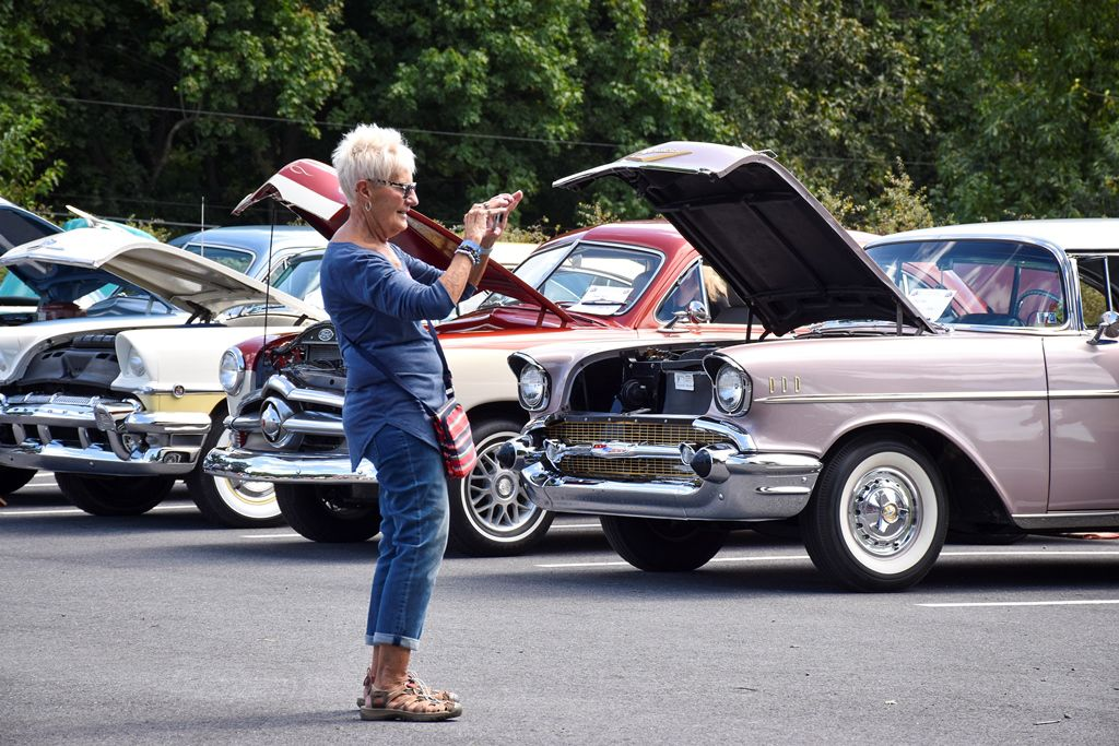 Mary Alice Herner stops to take a photo of some of the colorful vehicles on display.