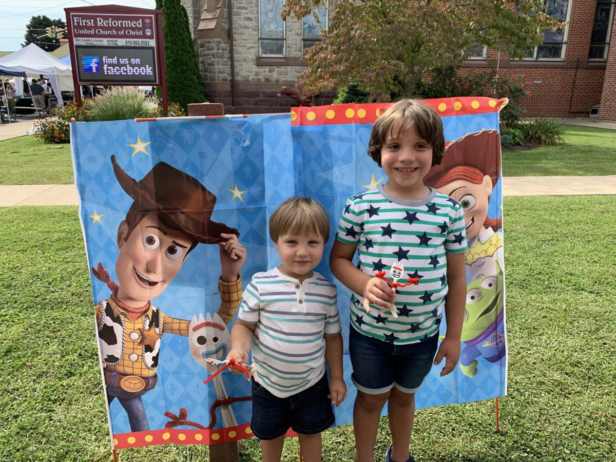 "Kids made their own Forky and pose for a photo in front of a ""Toy Story 4"" backdrop"