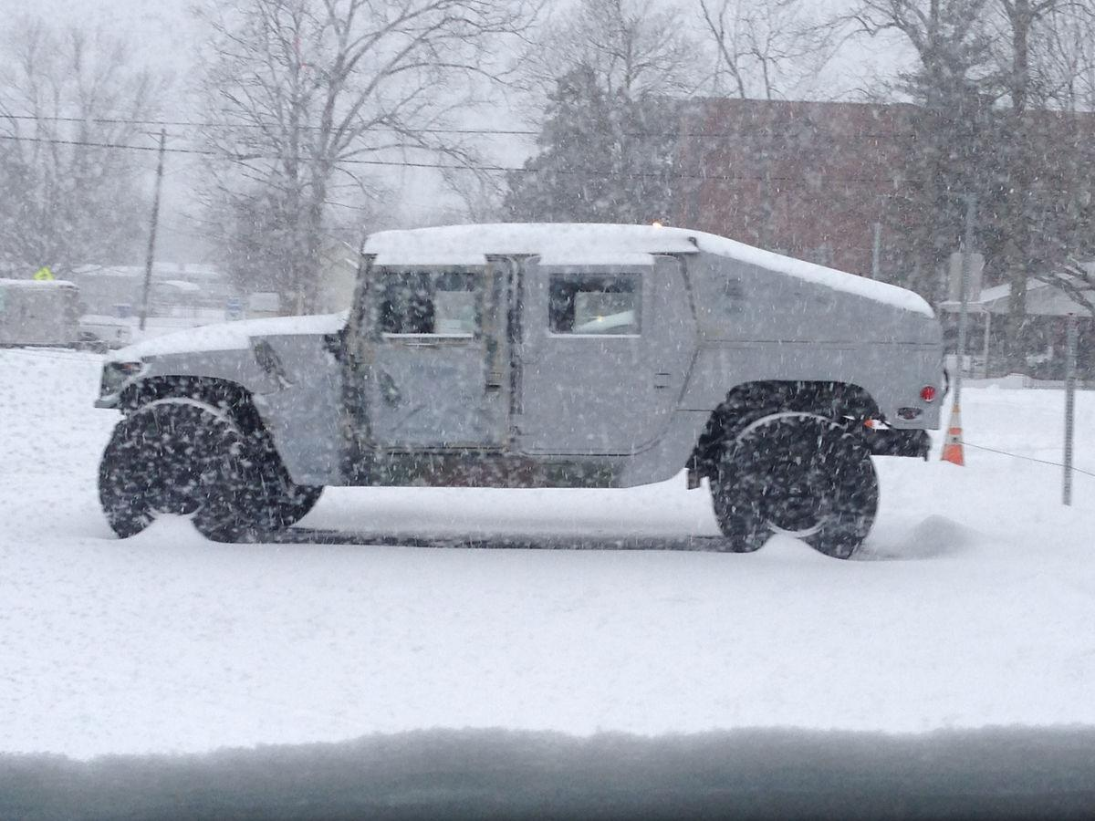 Military surplus humvees provide big lift after storm