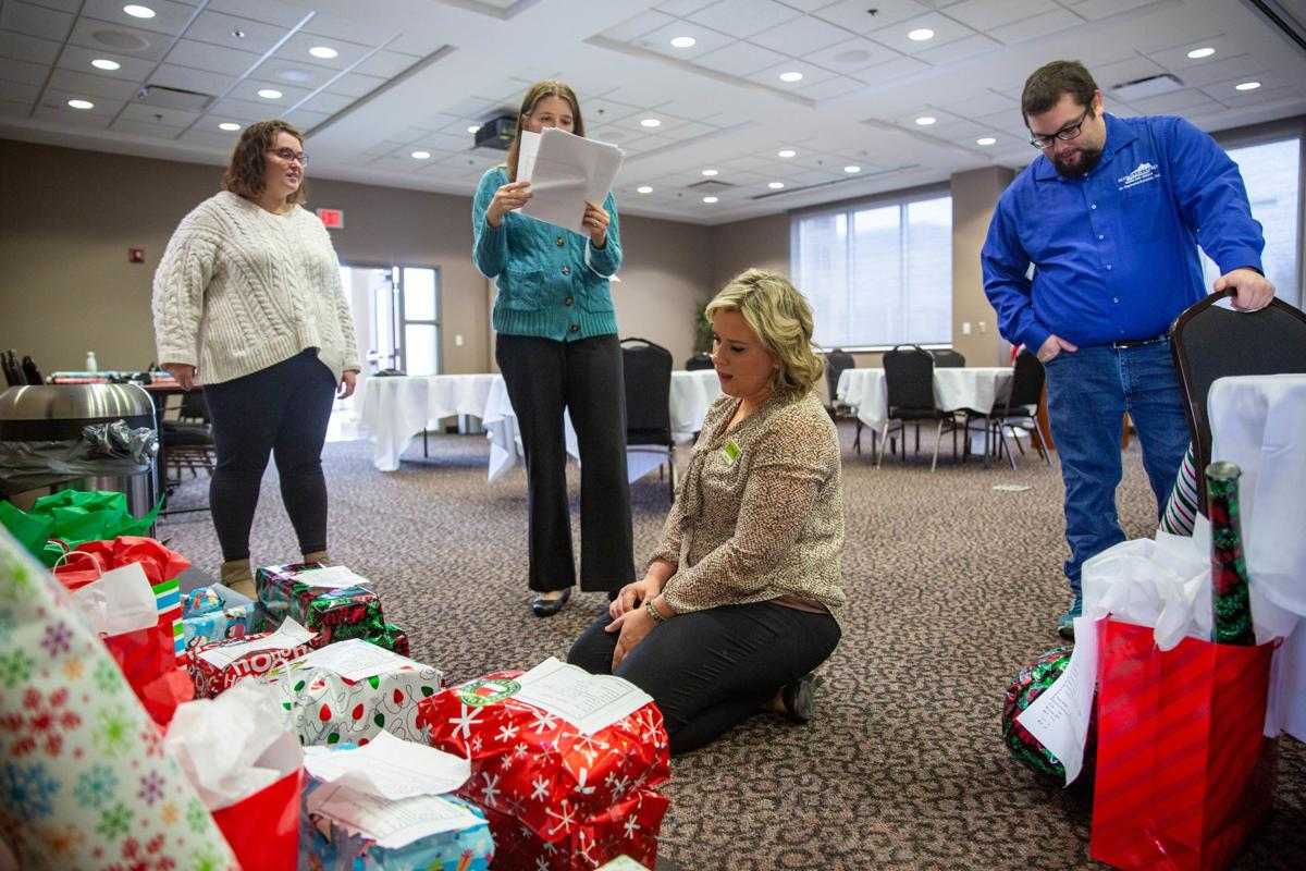 Young Professionals wrap presents for Family Enrichment Center children