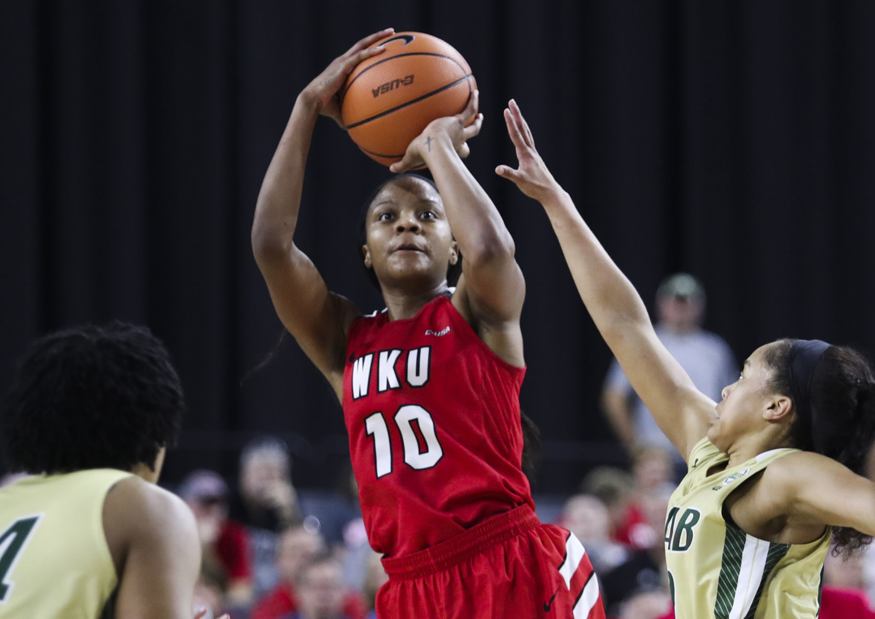 Lady Toppers win Conference USA Championship Brown