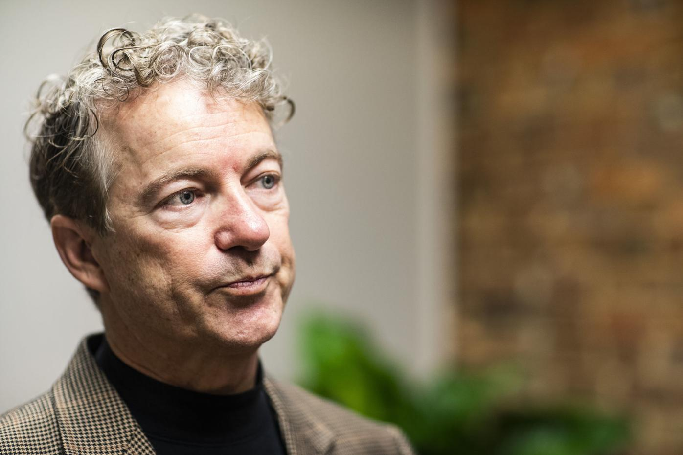 Rand Paul speaks to media at his office
