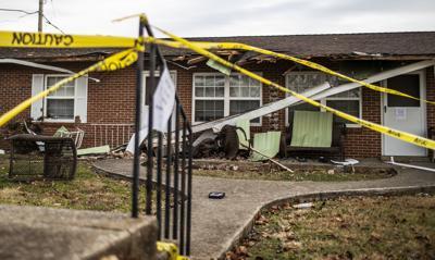 Van hits apartment, three passengers hurt