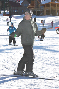 Ski instructor lights the way for downhill participants