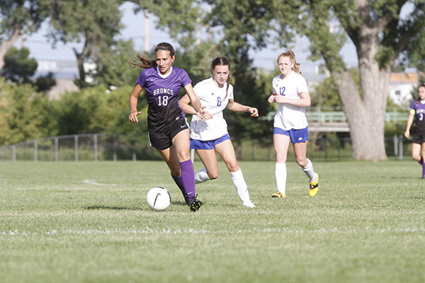 Bronc girls win home opener