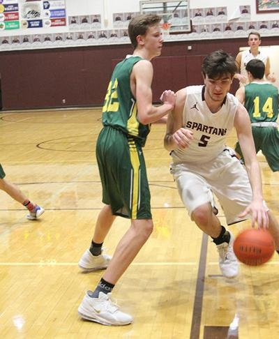 Spartans roll past Hill City 95-44