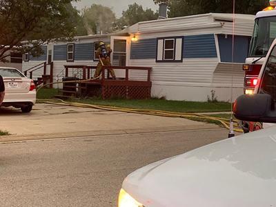 Man injured in trailer fire