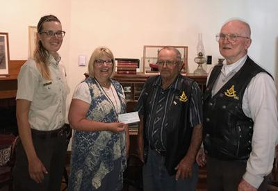 Booth Society receives $1,000 donation for Von Bayer Museum renovation project