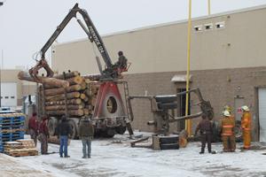 logging trailer plows into walmart