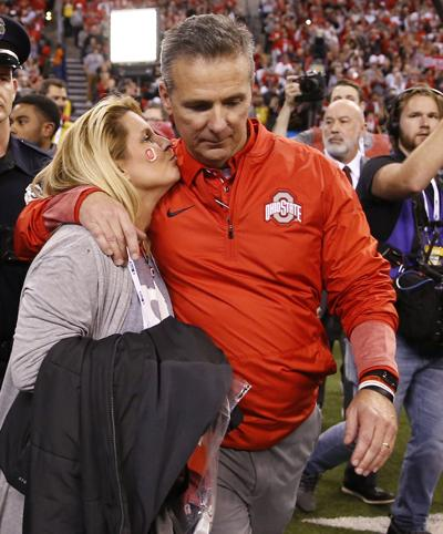 Ohio State Buckeyes head coach Urban Meyer gets a kiss after his team's 27-21 Big Ten Champsionship win over the Wisconsin Badgers at Lucas Oil Stadium Sunday, Dec. 3, 2017 in Indianapolis.