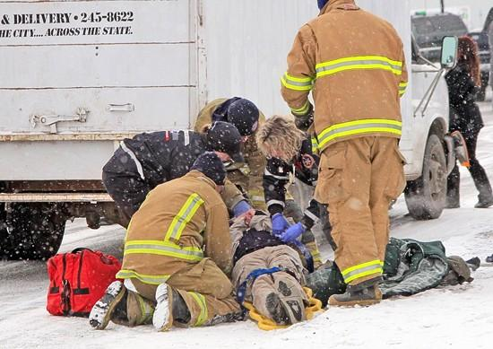 Cargo van hits man in Heights