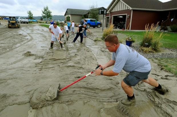 Brian Molloy shovels mud