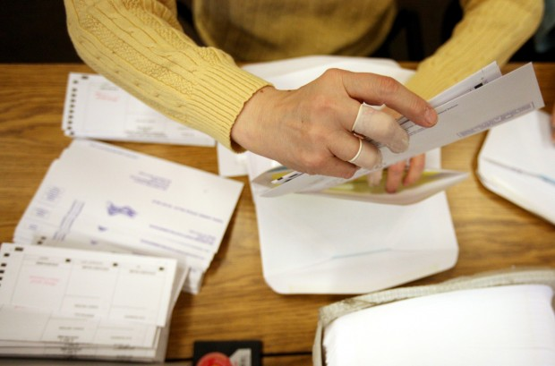 A worker stuffs primary ballots