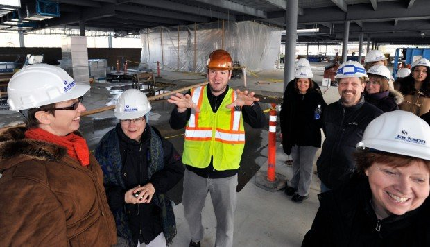 Kris Koessl, center, from A&E Architects leads a tour of library