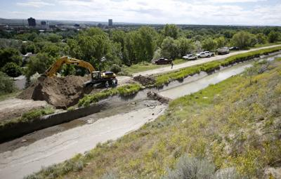 Irrigation company drains and digs up ditch above water-logged homes in Billings