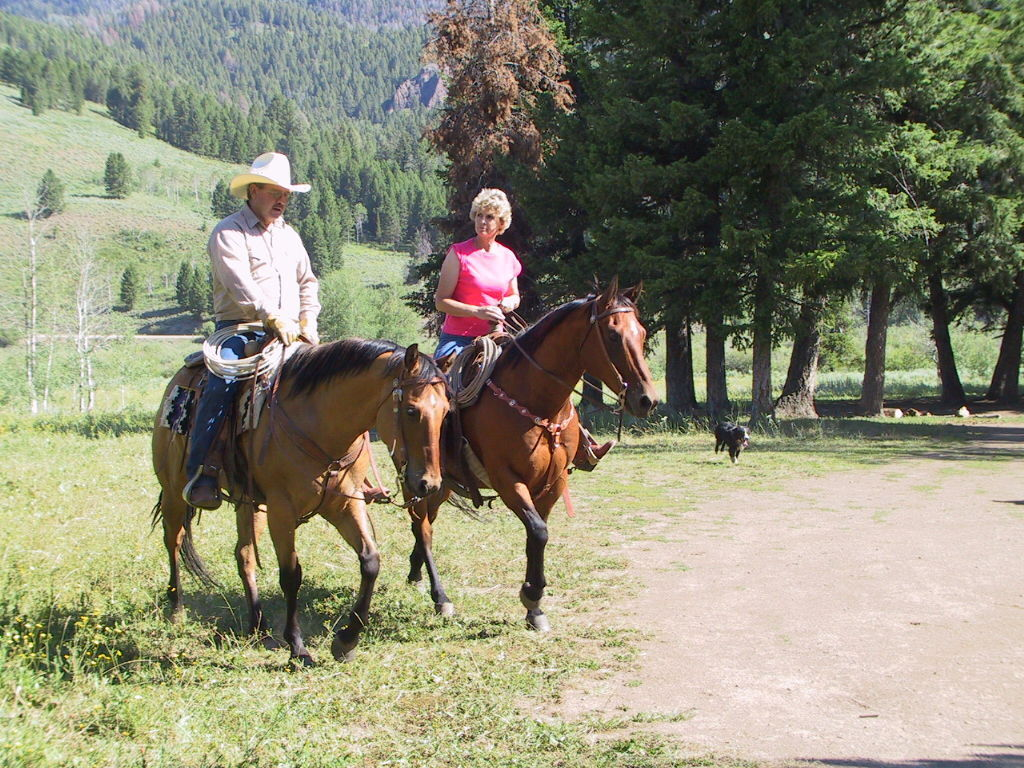 Nick and Jackie Hillman ride near their ranch