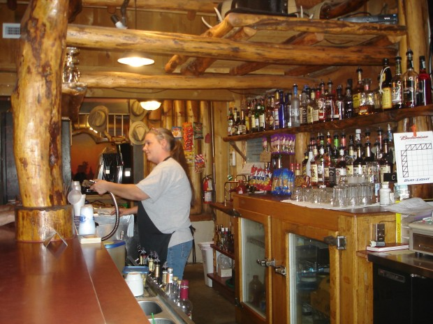 Trudy Bowman tends bars at Carter's Camp