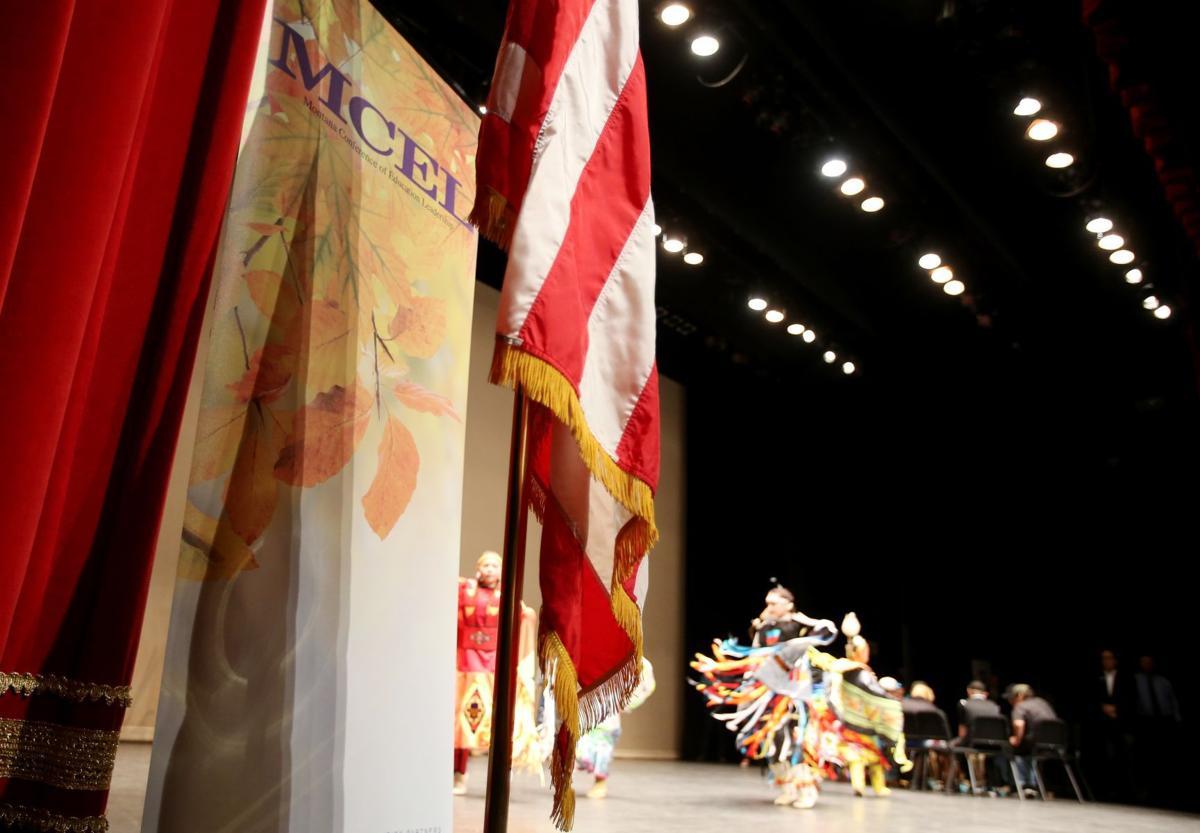 Dancers perform a fancy shawl dance