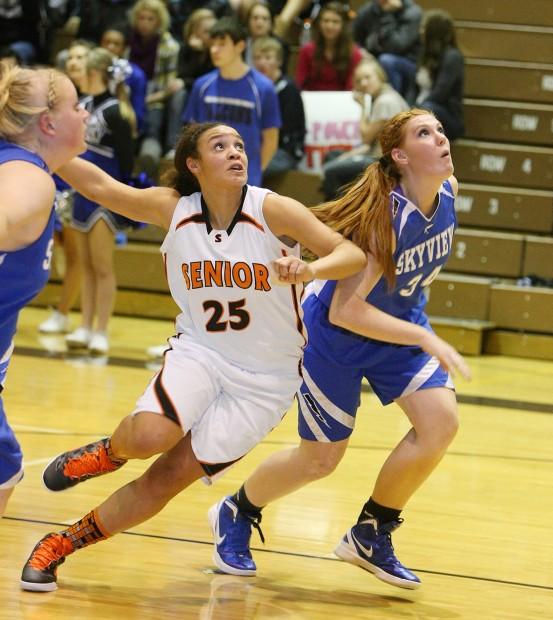 Rachel Koehler of Senior and Skyview's Tenika Capouch look for a rebound