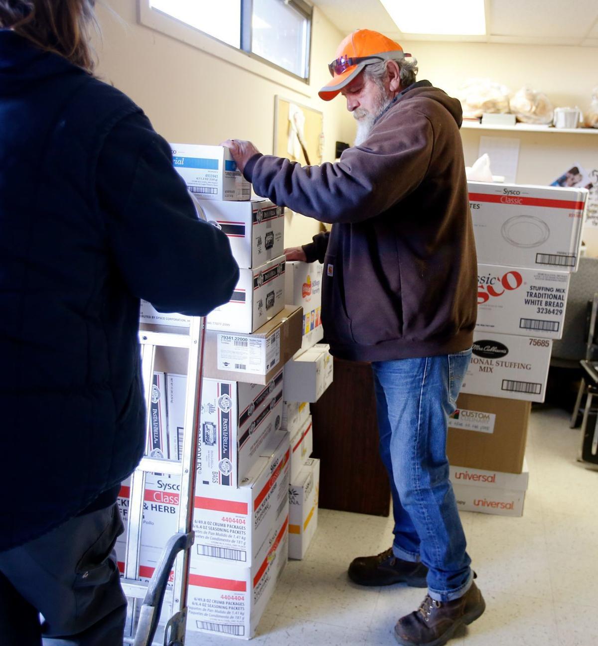Volunteers Stock Up Hub's Empty Food Pantry In Downtown