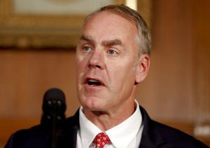 Environmental groups plan to greet Ryan Zinke with billboards, ads when he returns to Montana