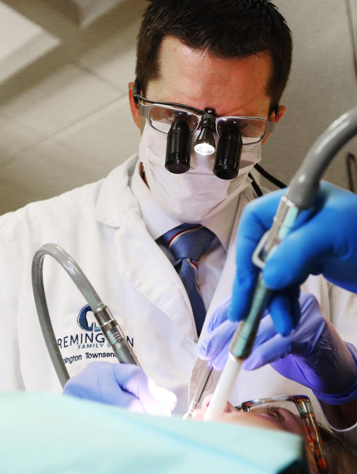 Dr. Remington Townsend works on filling a cavity