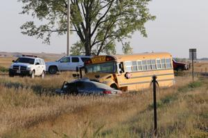 1 hospitalized after car turns in front of school bus carrying Plentywood volleyball team