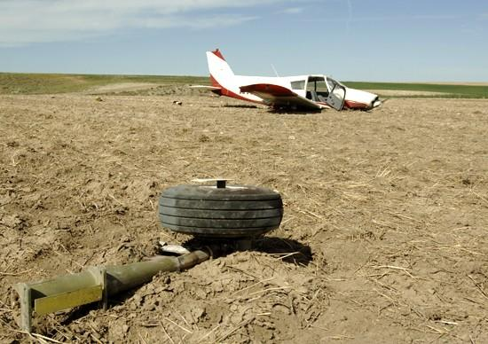 Pilot injured after crashing in field