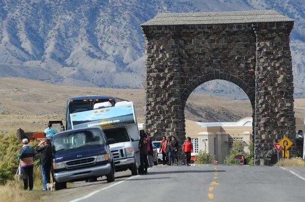 Tourists gather near the Roosevelt Arch