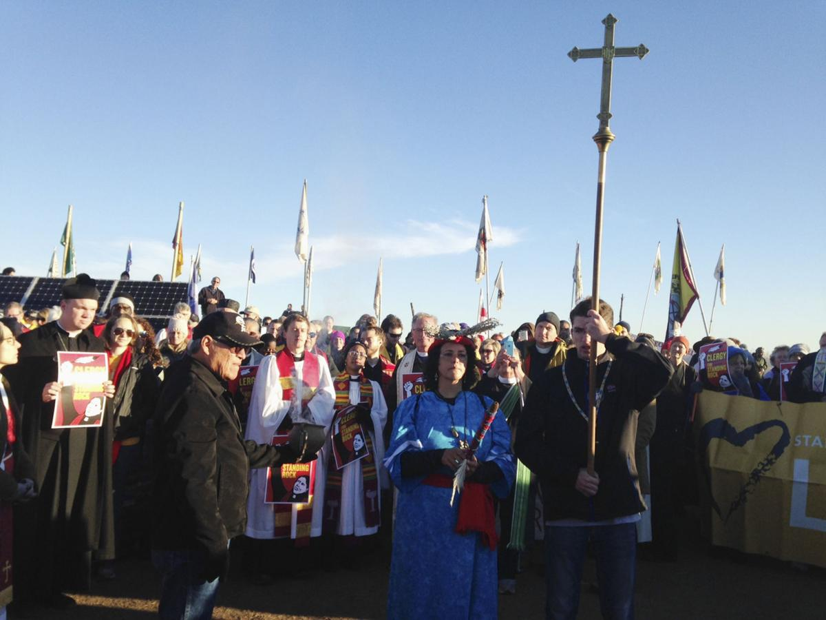 Clergy join protesters