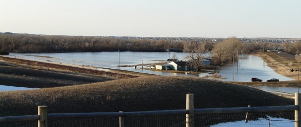 Milk River surrounds a home