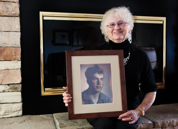 Patricia Littleton Duncan poses with a photo of her late brother-in-law