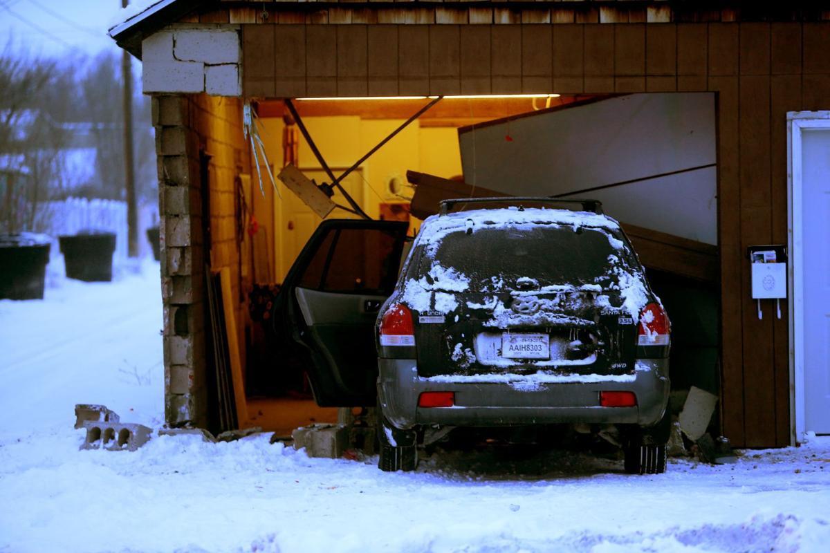 SUV crashes into house