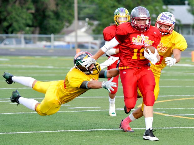 West's Troy Arntson heads for a touchdown