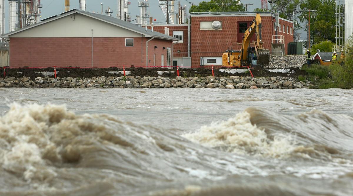 Laurel builds dike around water plant