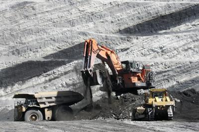 A loader fills a haul truck full of coal